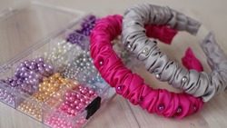 Fuchsia and soft gray color handmade scrunchy or scrunchies headband made out of satin silk fabric texture. A hairband or headpiece with ruffle pattern and beads as embellishments.