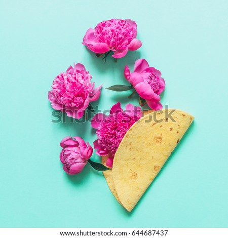 fuchsia peonies are in the tortilla or pancake. the concept of fast street food