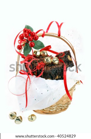 Fudge brownies with peanut butter chips fill a festive Christmas gift basket.  Red bows and golden jingle bells with sparkly tissue paper decorate the basket.