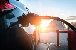 Fuel car. Pump petrol from nozzle in vehicle tank. Gasoline, oil gas station. Economy business with diesel transport. Automotive transportation concept.