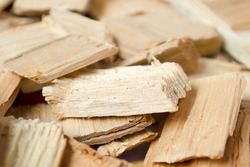 Fuel chips for smoking or heating. Close-up of wood fuel chips, wood chips. Background of small pieces of wood chips for a barbecue or home heating.