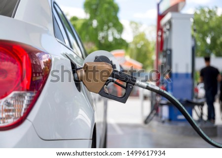 Fuel dispensing pumps at gas station. Outdoor. #1499617934