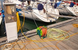 Fuel filling station, Concierge service on the pier, water supply hose to the boat is wound on a spool. Refueling the boat with electricity, water and fuel. The concept of developing convenient boat.
