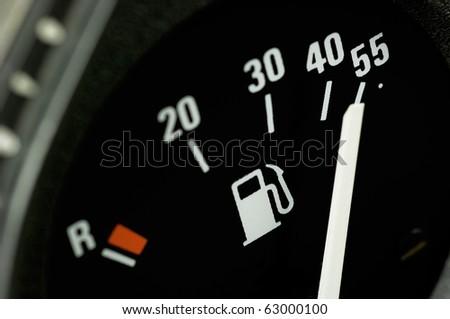 Fuel gauge of a car - stock photo