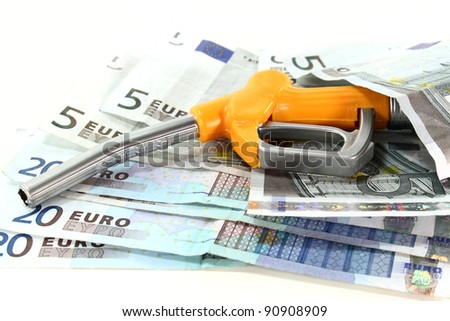 fuel nozzle and euro notes on a white background