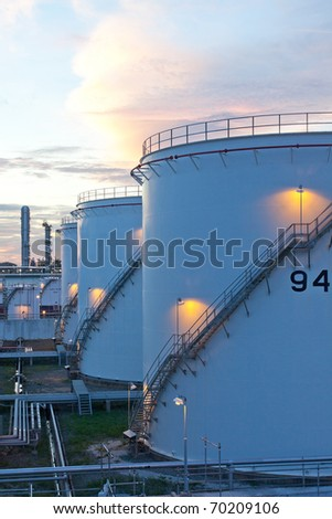 Fuel silo tanks at the petrochemical plant in the morning sphere, the backup energy of the nation