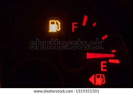 fuel symbol on modern car dashboard.dashboard lights signal display before start driving #1319351501