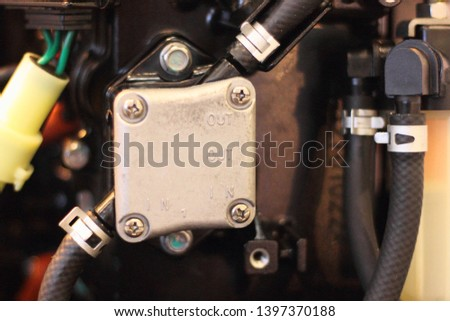 Fuel system, low pressure gasoline pump of boat outboard motor close up #1397370188