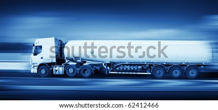 fuel truck in motion on highway and blurred background, monochromatic