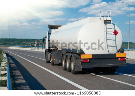fuel truck rides on road, white blank color, rear view, one object on highway #1165050085