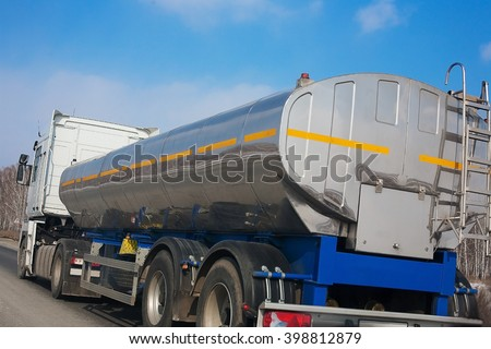 fuel truck with the chromeplated tank goes on the highway #398812879