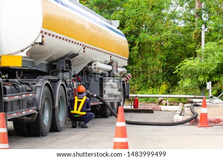 Fueling Up a Freight Transport Truck,Fuel Delivery Tanker #1483999499