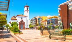 Fuengirola old town view and central square Plaza de la Constitucion. Popular touristic town in Andalusia province, near Malaga, Spain