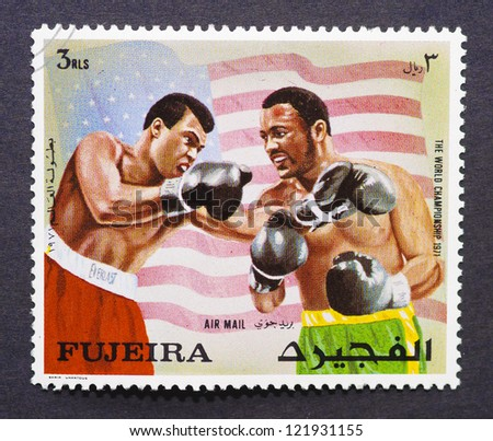 FUJAIRAH - CIRCA 1971: postage stamp printed in Fujairah of Union Arab Emirates showing an image of the fight between Muhammad Ali vs Joe Frazier in 1971 for the Heavyweight Championship, circa 1971.