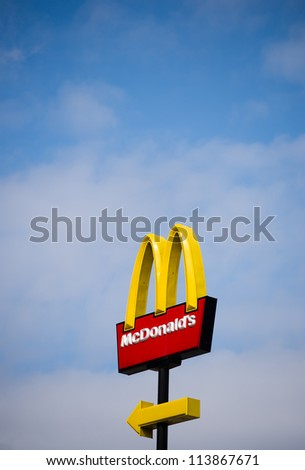 FUJIAN, CHINA - JUNE 29:  McDonalds logo on blue sky background on June. 29, 2012 in Fujian, China.  McDonald's Corporation is the world's largest chain of hamburger fast food restaurants.