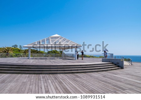 """FUJISAWA, KANAGAWA / JAPAN - APRIL 28 2018 : Scenery of Enoshima Observatory Lighthouse """"Sea Candle"""". Various events are taking place at the deck under the lighthouse. #1089931514"""