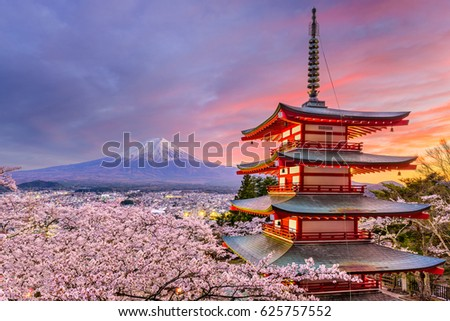 Photo of Fujiyoshida, Japan at Chureito Pagoda and Mt. Fuji in the spring with cherry blossoms.