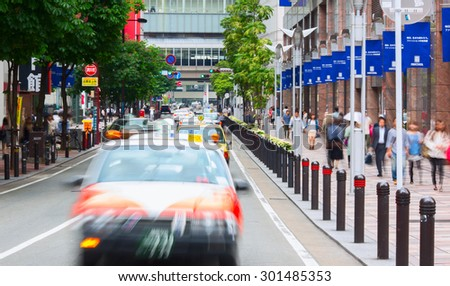 FUKUOKA, JAPAN - 14 MAY 2013: Downtown of Fukuoka city during peak time. Taxi cars aligned on the street. Fukuoka city, Japan.