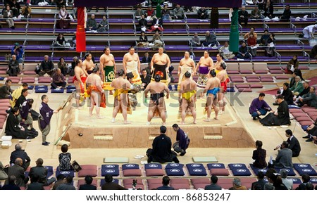 FUKUOKA, JAPAN - NOVEMBER 17: Sumo wrestlers gather around the referee at a Grand Sumo tournament on November 17, 2010 in Fukuoka, Japan. There are six official tournaments held each year in Japan.