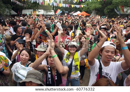 FUKUOKA, JAPAN - SEPTEMBER 5: The crowd cheers on Indigo Jam Unit at the 18th annual Sunset Live at Keya Beach, Fukuoka, Japan Sept 5, 2010. Over 15,000 people attended the 3 day music and art festival.