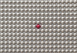 Ful Frame of Metal Magnetic Balls for background. The Neocube Spheres with one red sphere. Stand out of the crowd