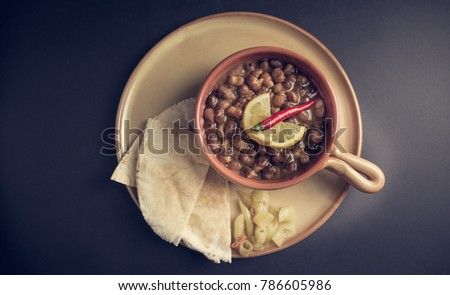 Ful Medames - is an Egyptian dish of cooked Fava beans served with vegetable oil, lemon, chili. It is a popular traditional/oriental food in Egypt and all middle east. #786605986