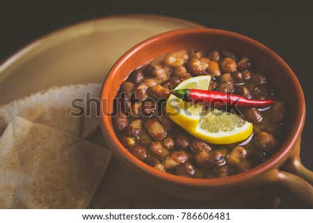 Ful Medames - is an Egyptian dish of cooked Fava beans served with vegetable oil, lemon, chili. It is a popular traditional/oriental food in Egypt and all middle east. #786606481