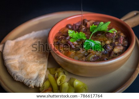 Ful Medames - is an Egyptian dish of cooked Fava beans served with vegetable oil, lemon, parsley. It is a popular traditional/oriental food in Egypt and all middle east. #786617764
