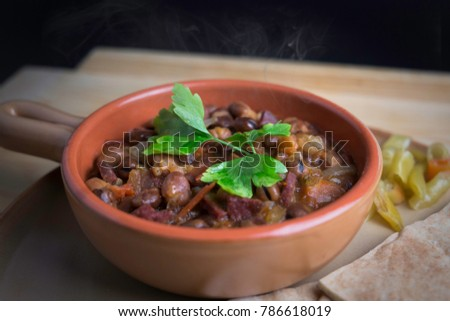 Ful Medames - is an Egyptian dish of cooked Fava beans served with vegetable oil, lemon, parsley. It is a popular traditional/oriental food in Egypt and all middle east.