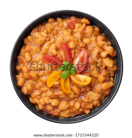 Ful Medames or Fava Beans in isolated on white. Foul Mudammas is a Egyptian, Lebanese, Syrian, Eritrean, Israeli cuisines breakfast dish of cooked beans with cumin, tomatoes, parsley. Сток-фото ©
