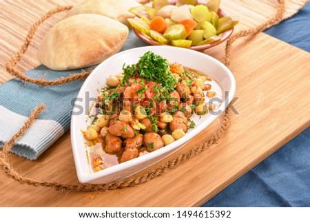 Ful Mudammas, Lava Beans Styled and Garnished on White Bowl #1494615392