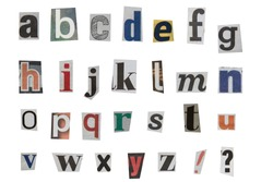full alphabet of lowercase letters cut out from newspapers