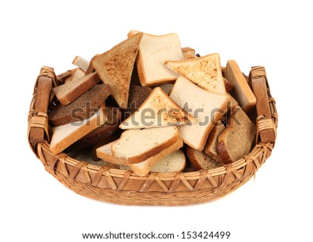 Full basket of different sliced bread. Isolated on a white background.