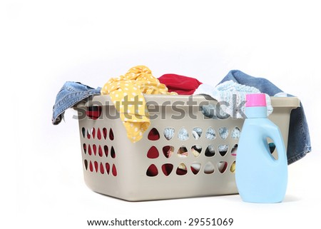 Full Basket of Dirty Laundry With Detergent Ready to Be Washed