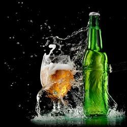 Full beer bottle and a glass of beer splash