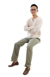 Full body Asian man sitting on a transparent block over white background