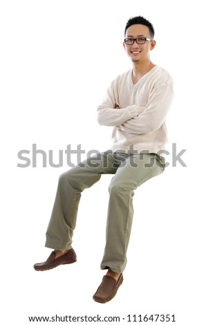 Full body Asian man sitting on a transparent block over white background #111647351
