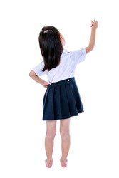 Full body. Back view of young preschool child in uniform standing akimbo. Asian girl writing with red crayon. Education and people concept. Isolated on white background. Great for your design or text.