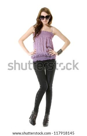 Full body beautiful stylish girl posing in studio