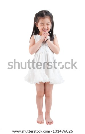 Full body East Asian girl making a wish with smiling, standing isolated on white background