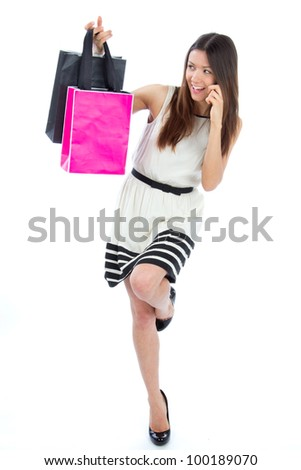Full Body Happy Beautiful sexy woman with colorful gift shopping bags cheerful smiling in contemporary casual dress on a white background