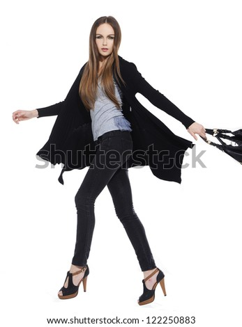 Full body image of an attractive young girl posing white background