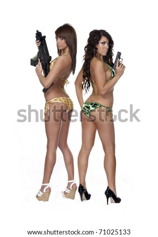 Full body image of two models, sexy young women with weapons. Studio photo, image isolated against white background