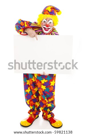 Full body isolated view of a friendly circus clown holding a black white sign.