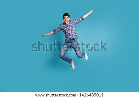 Full body length size photo of crazy humorous handsome carefree careless dreamy optimistic generation y millennial he him guy stretching arms hands to sides isolated pastel background