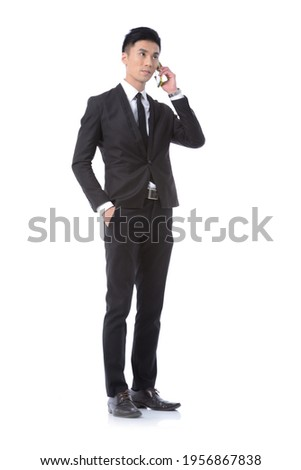 Full body Man business black suit ,tie with black pants ,shoes uses a, mobile ,phone,posing in studio Stock photo ©