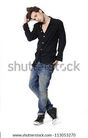 full body of a fashion man holding his jeans shirt
