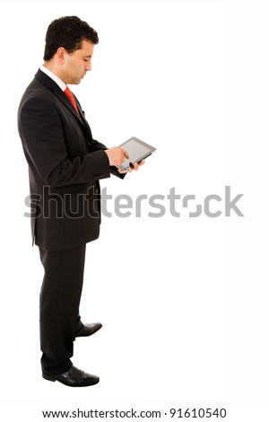 Full body of a young businessman using a tablet pc on white background