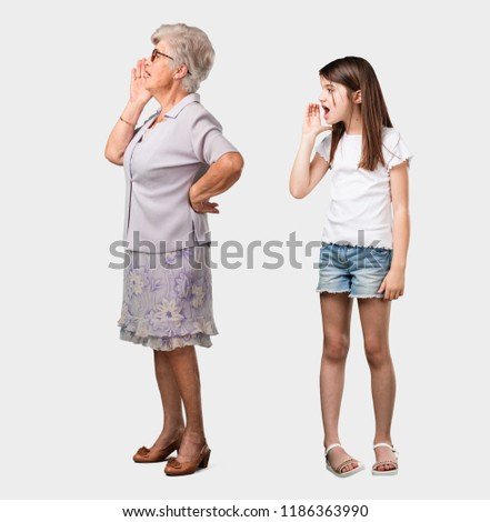 Full body of an elderly lady and her granddaughter screaming angry, expression of madness and mental instability, open mouth and half-opened eyes, madness concept