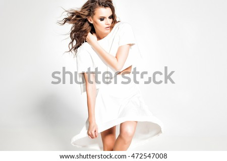 Stock Photo full body of beautiful woman model posing in white dress in the studio
